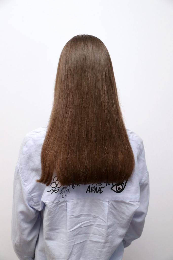 sleek is chic hair: straight hair back view