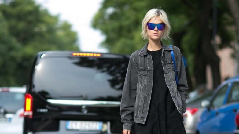 casual look girl wearing denim jacket walking on a street
