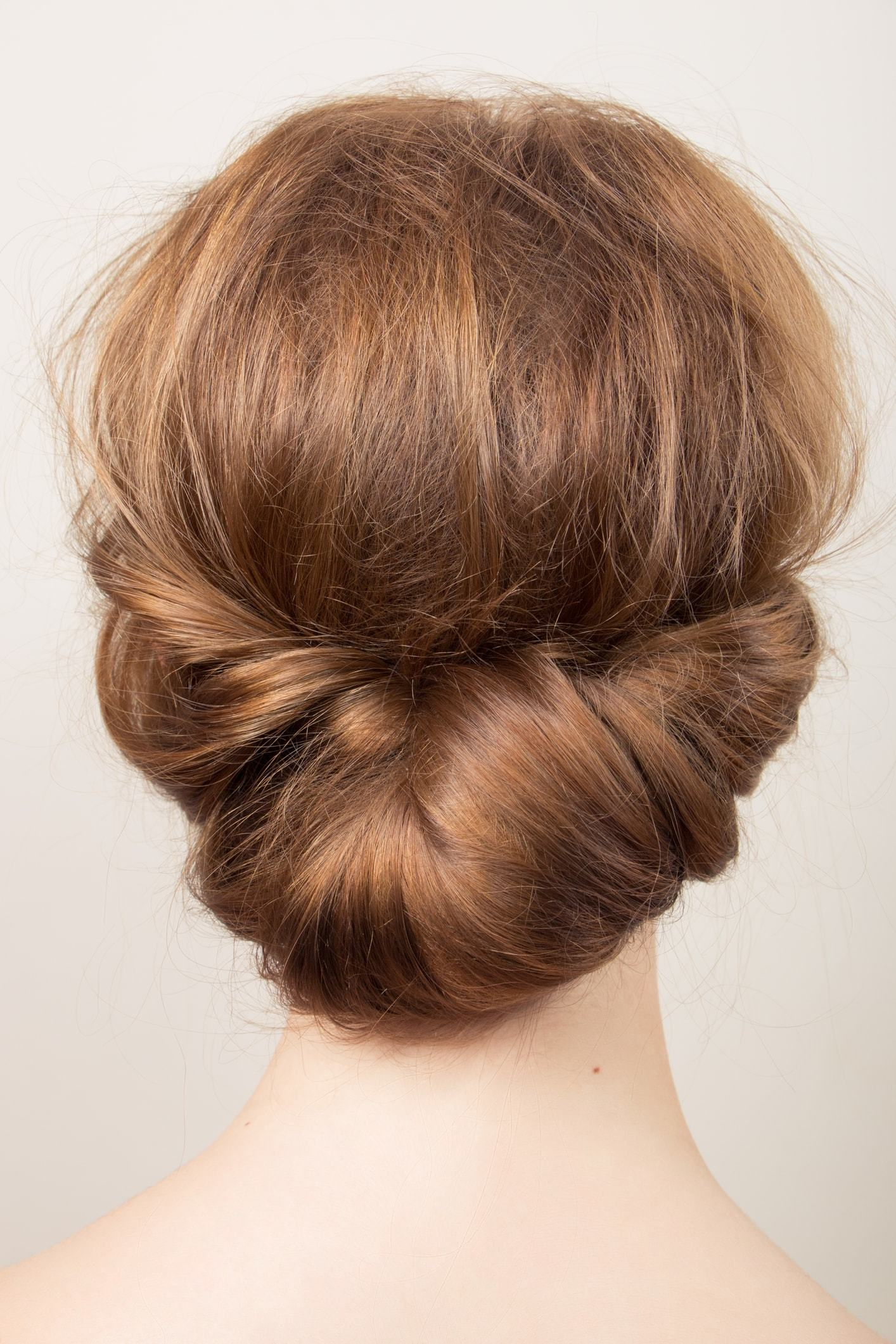 flower girl hairstyles tucked updo red hair