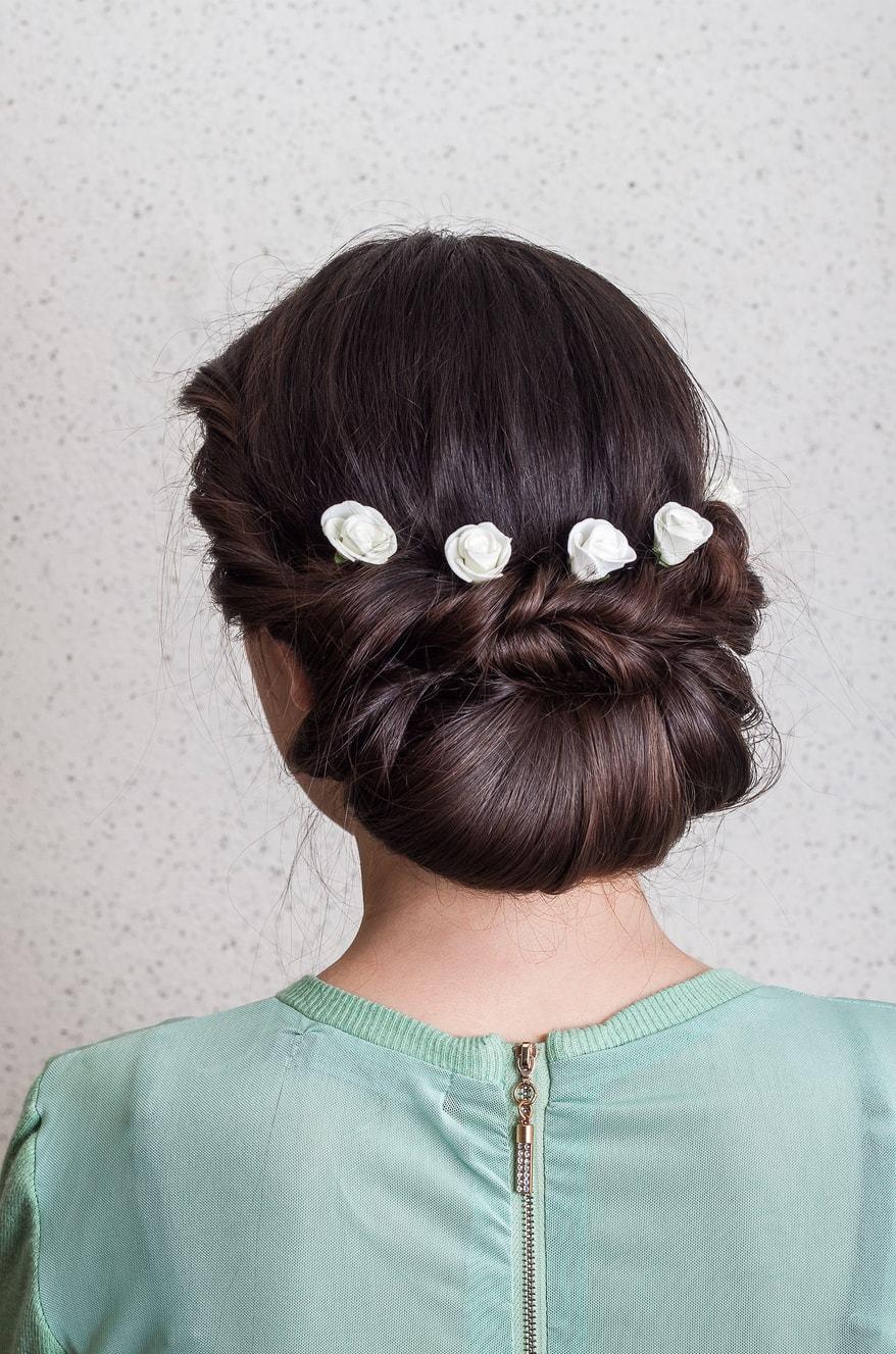 flower girl hairstyles twist updo white roses brunette hair