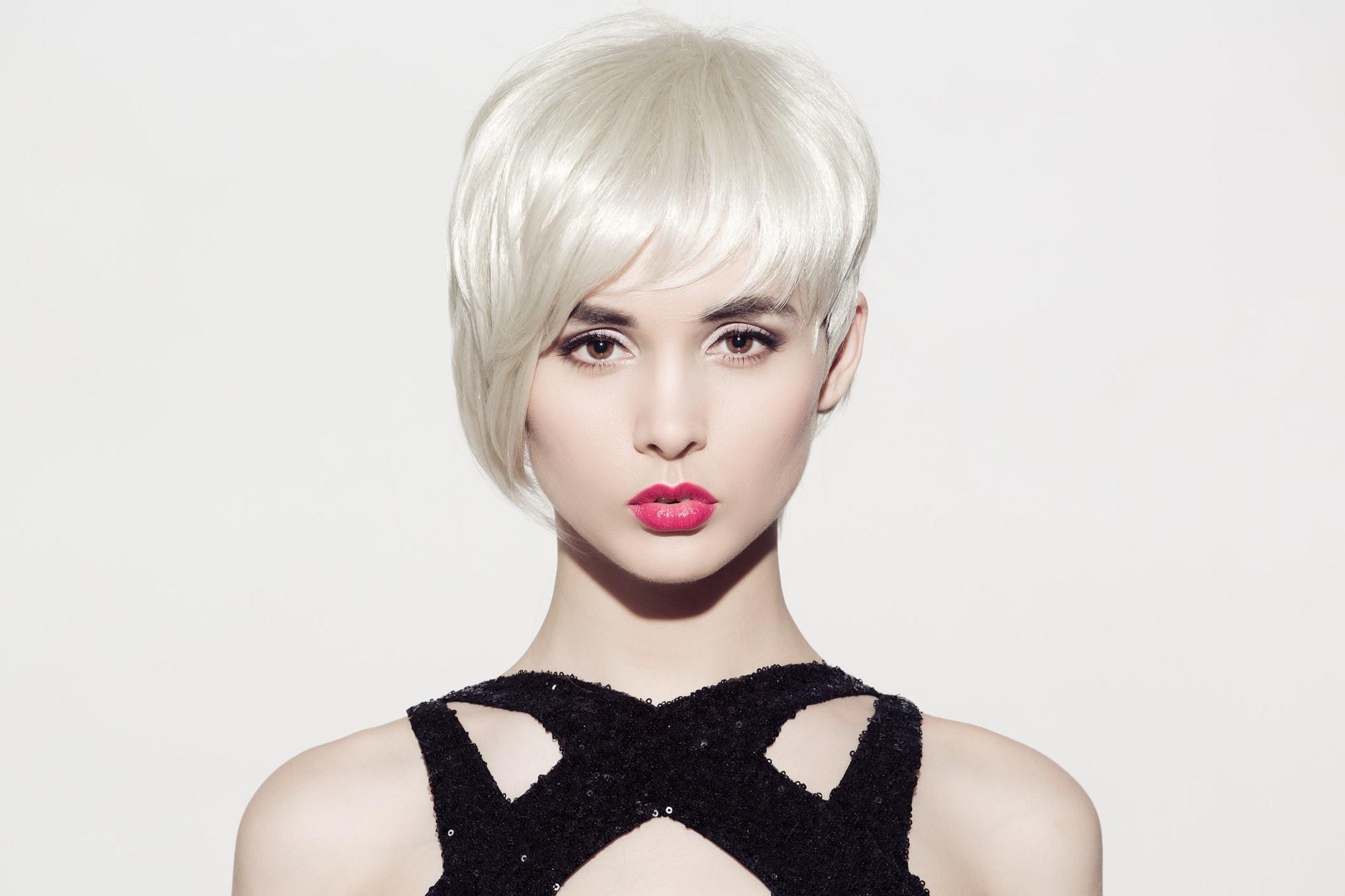 long pixie haircut bleach blonde bangs