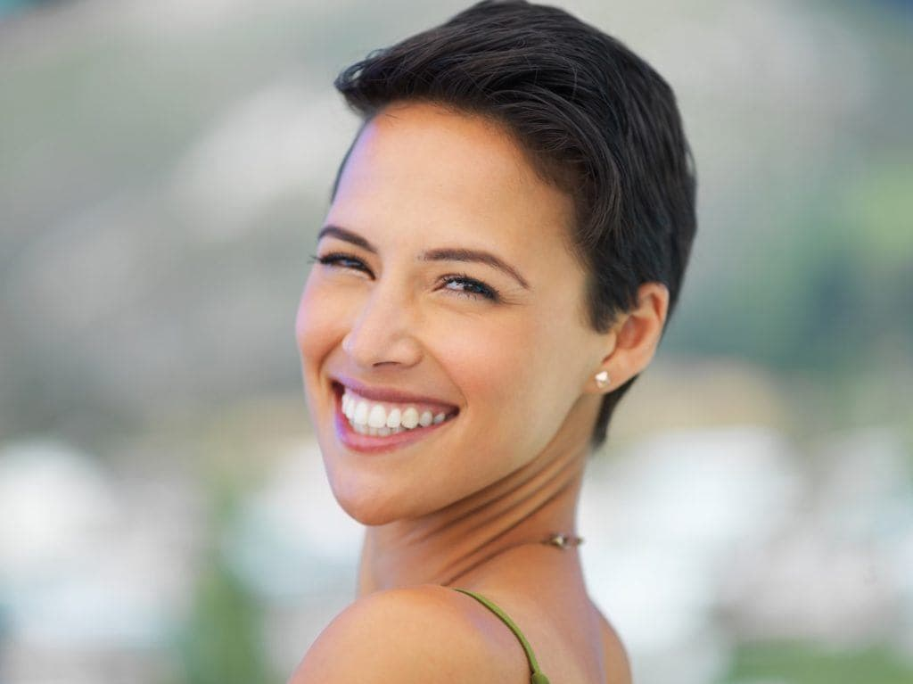 long pixie haircut styled brunette