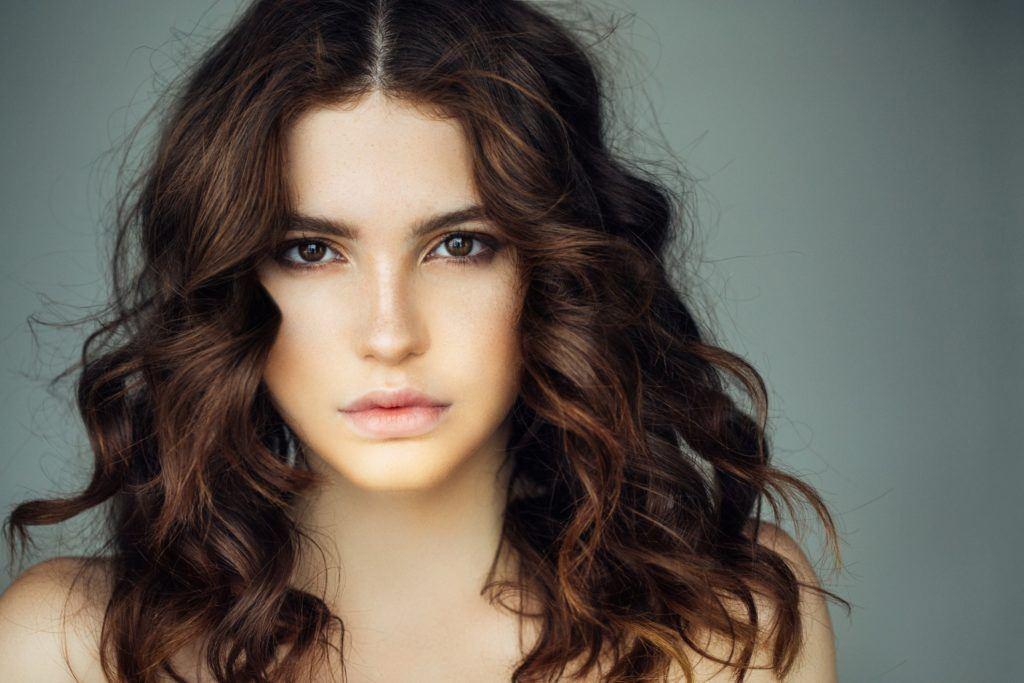 loose perm curling iron brunette curls