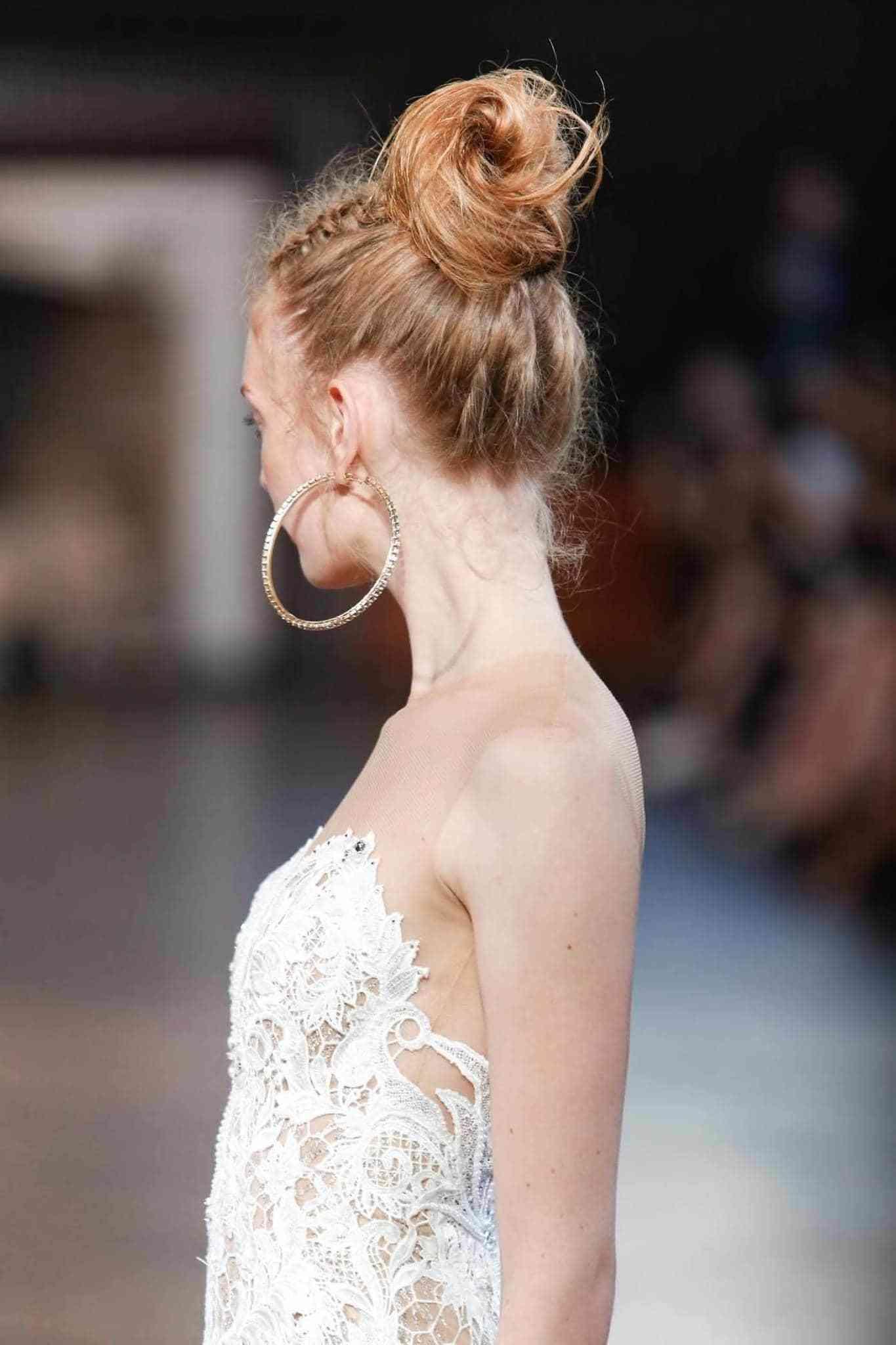 high bun with accent braid party braids