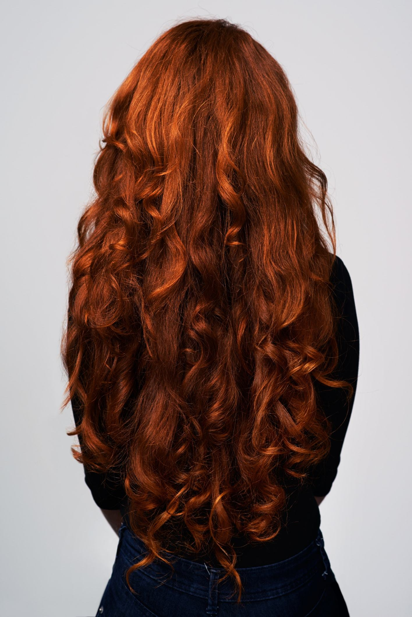 spiral perm long red loose curls