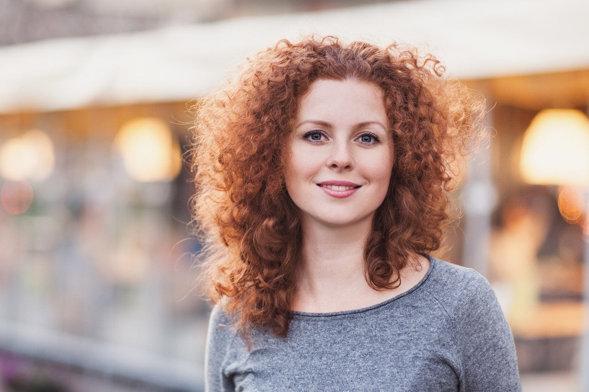 spiral perm red frizzy curls