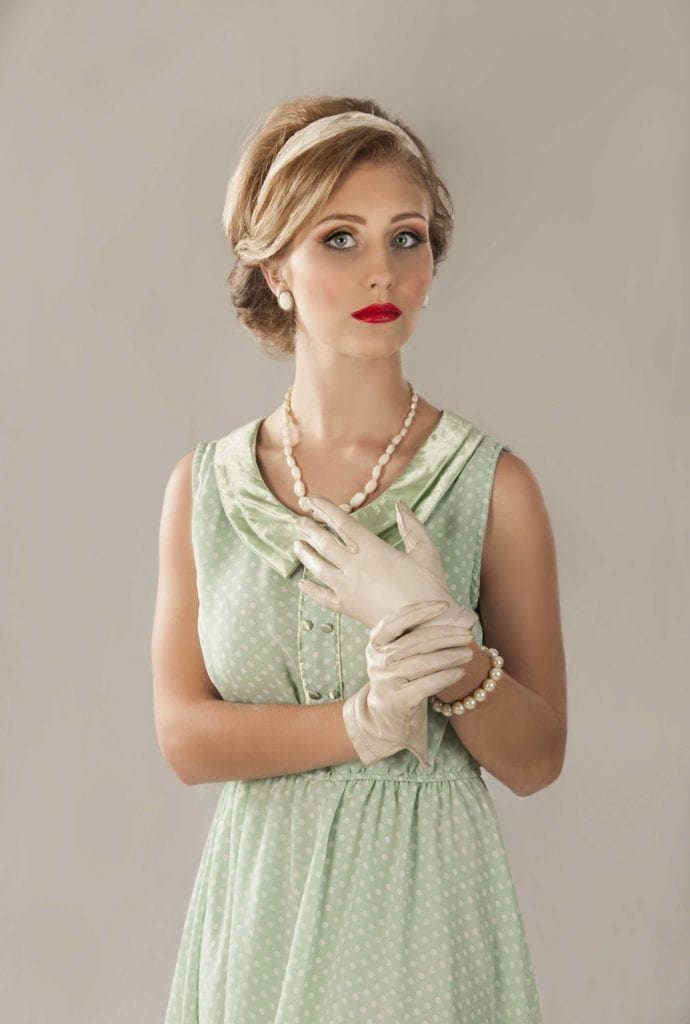 a vintage look of a woman holding her hand on grey background