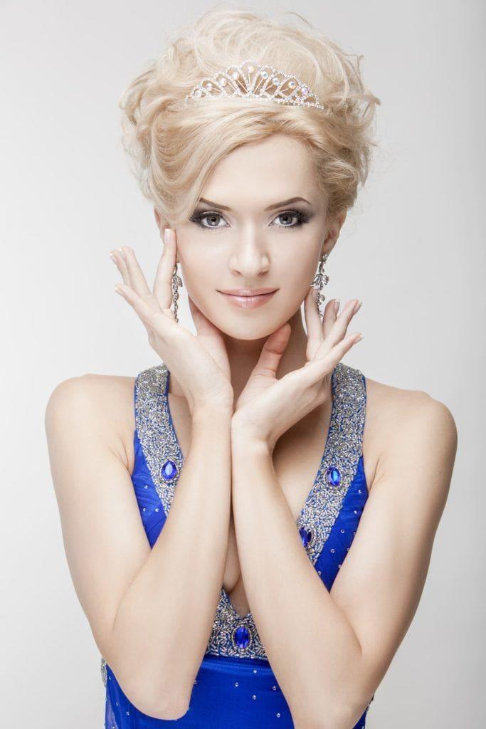 hairstyles with tiara voluminous blonde updo
