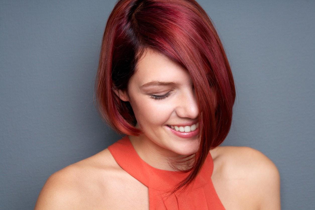 red balayage hair asymmetrical bob