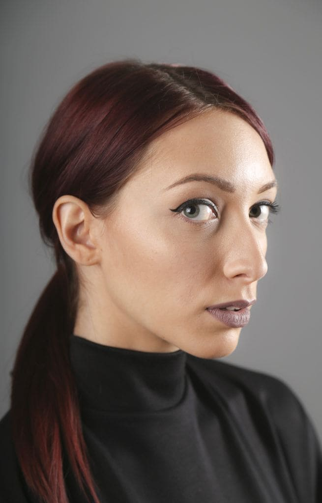 red balayage hair middle parted ponytail