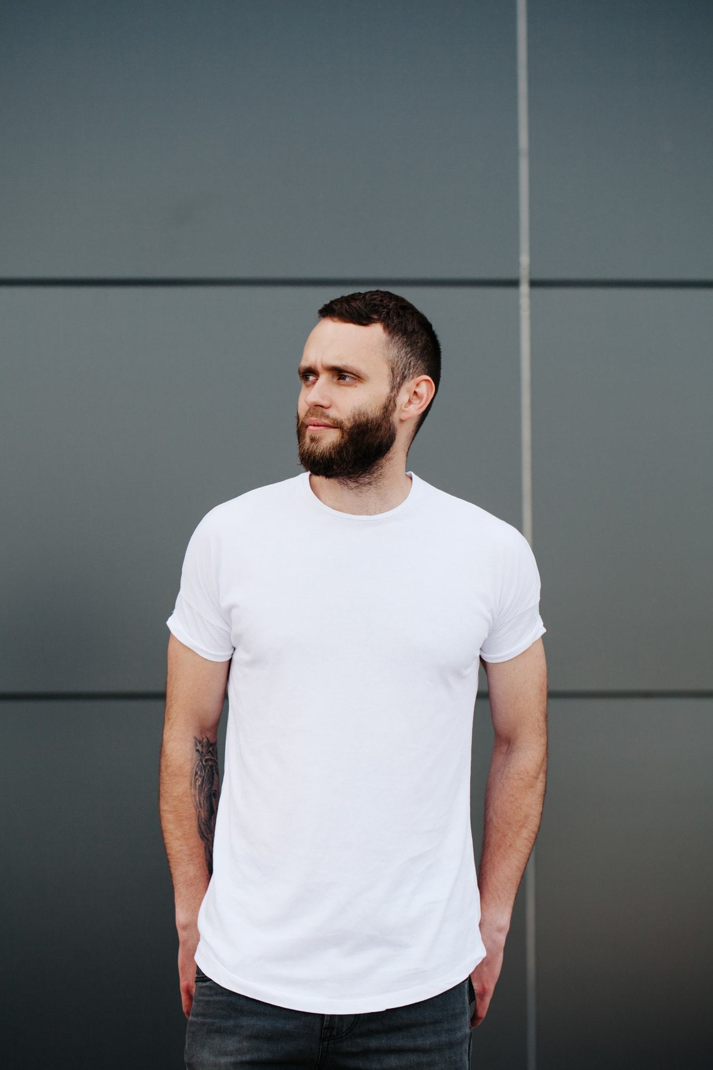 low fade haircut brunette closely shaven beard