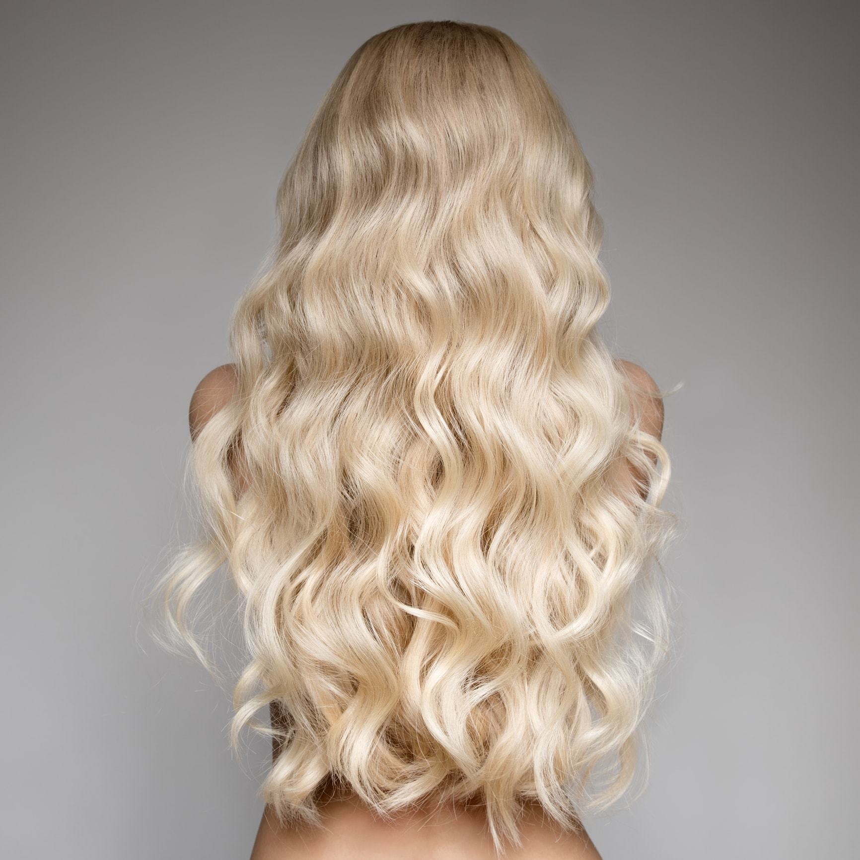curly perm long brushed through blonde curls