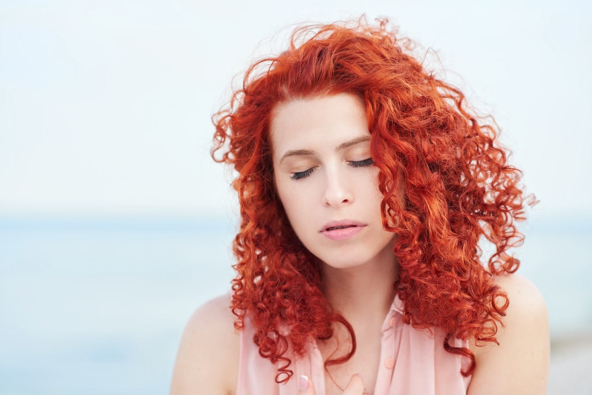 curly perm pop of red curls