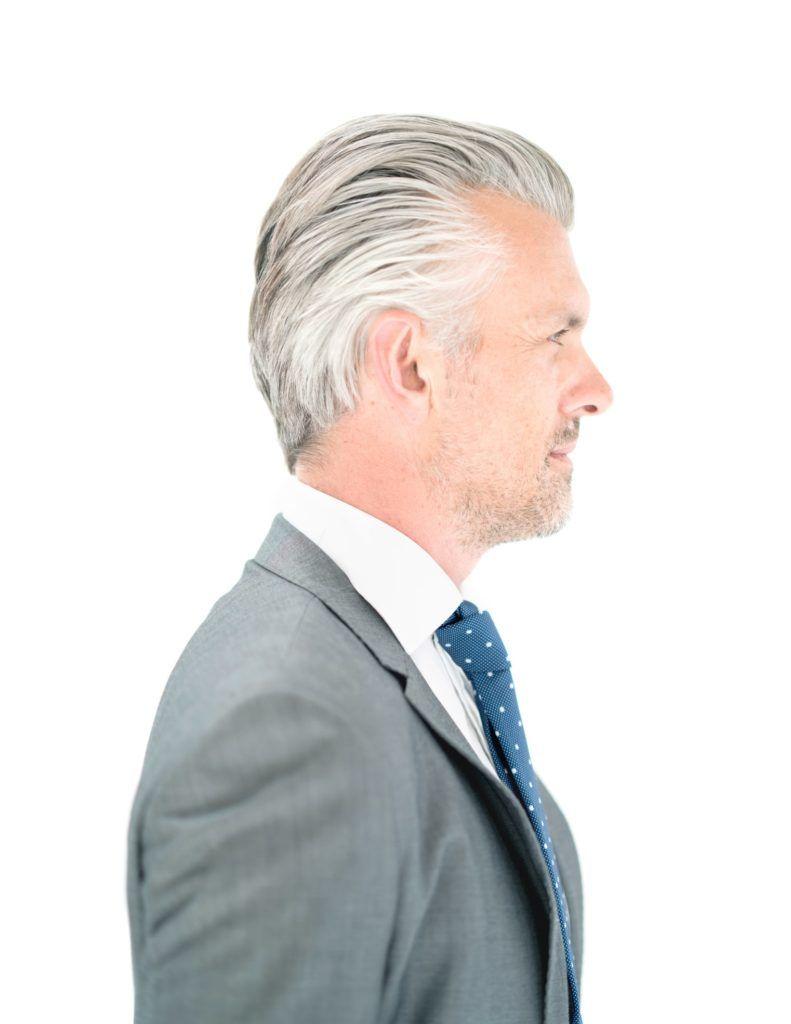 hairstyles for men over 50 slicked back white