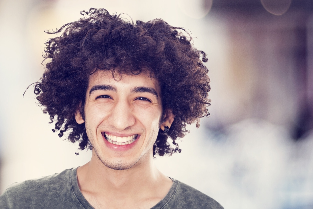 hairstyles for men with thick curly hair: mop top