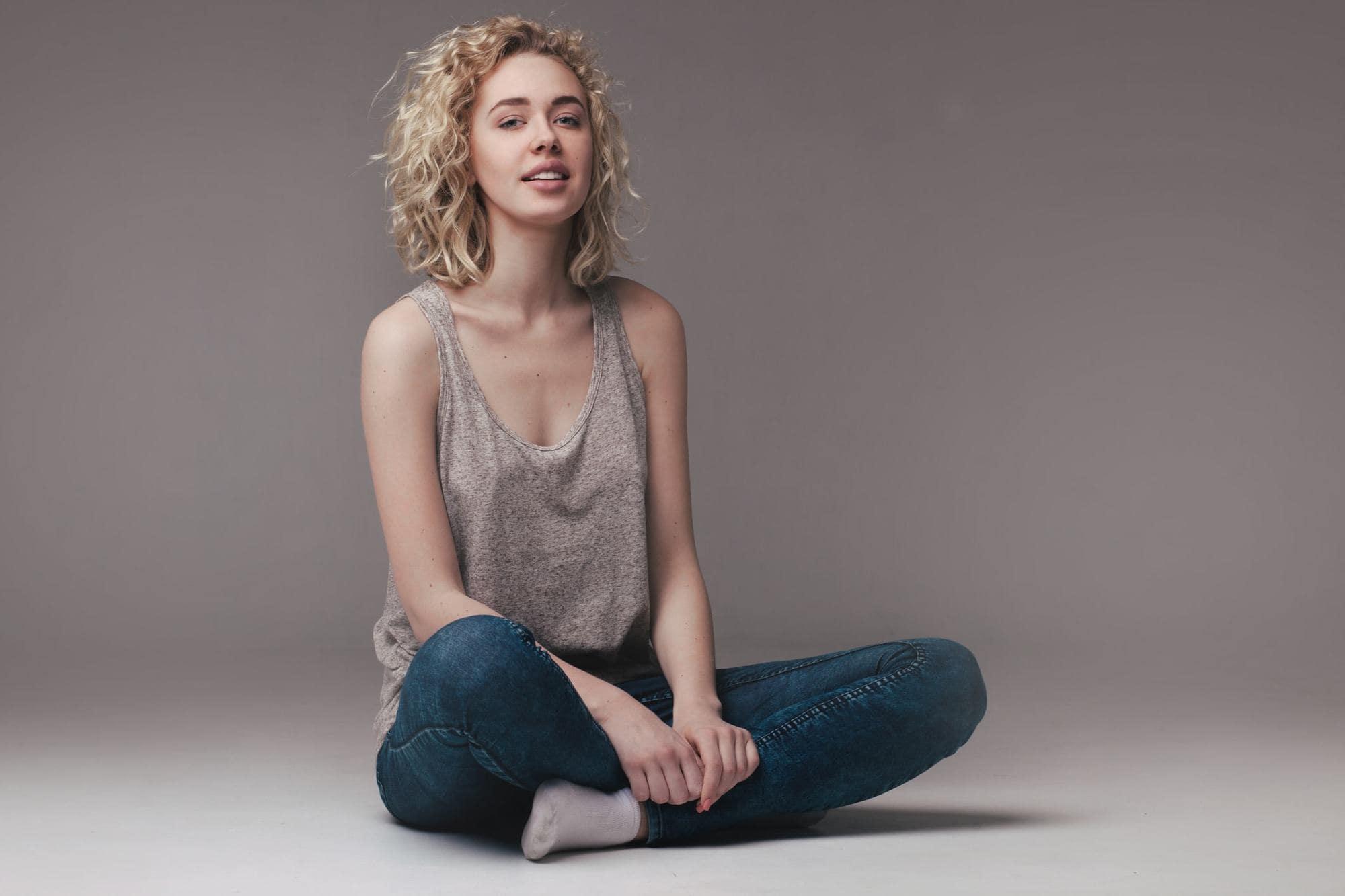 type 3 hair blonde girl sitting
