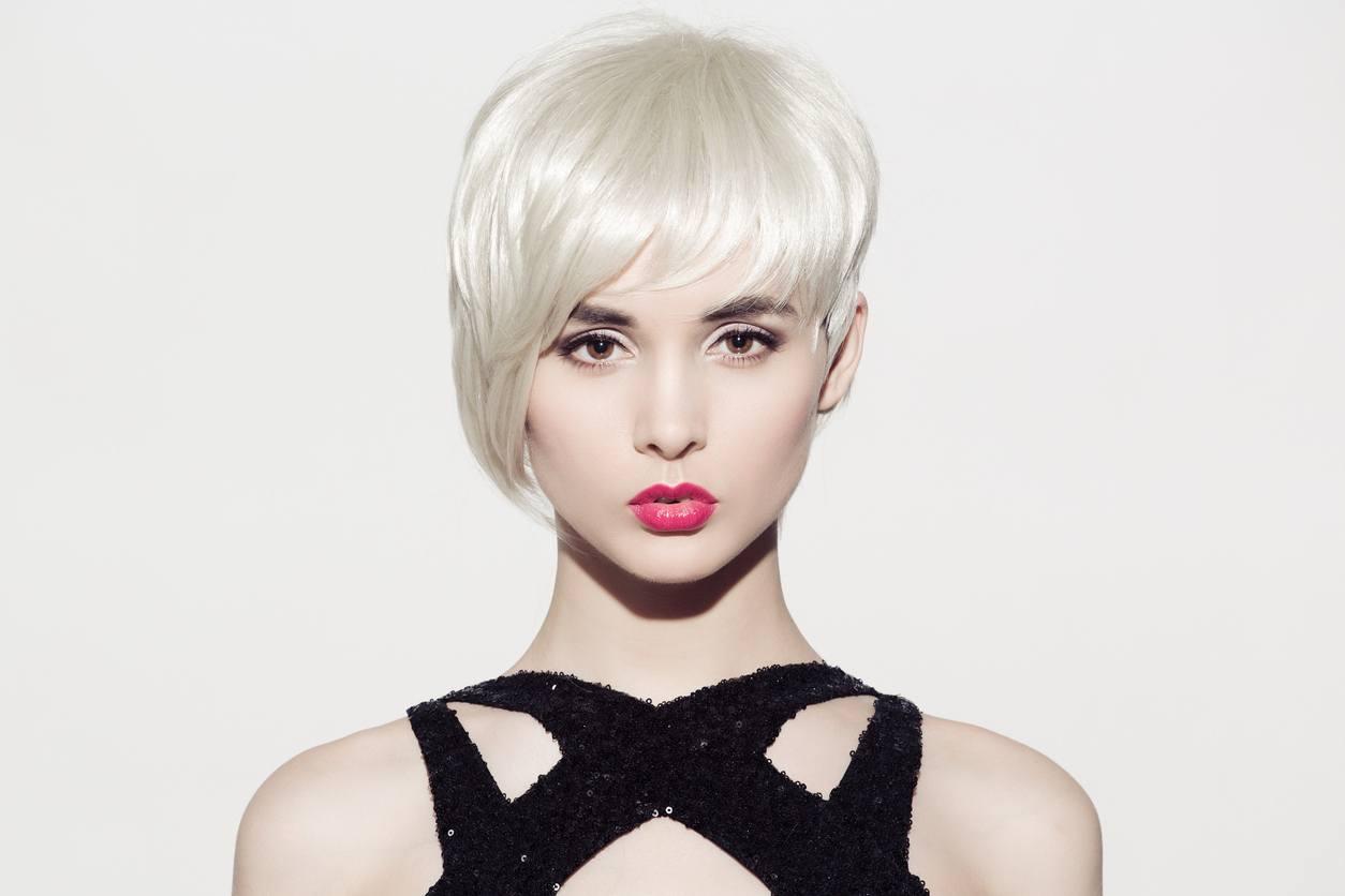 short blonde hair asymmetrical cut