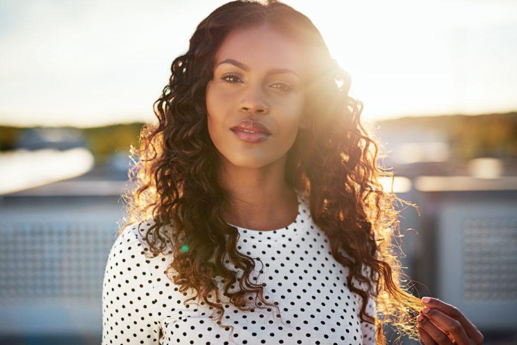 sew-in hairstyles: brown curls