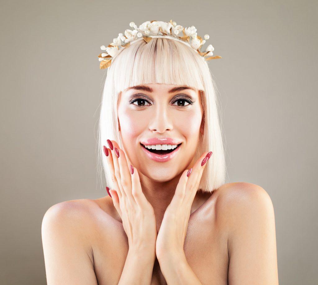 short bob with bangs bleach blonde flower crown