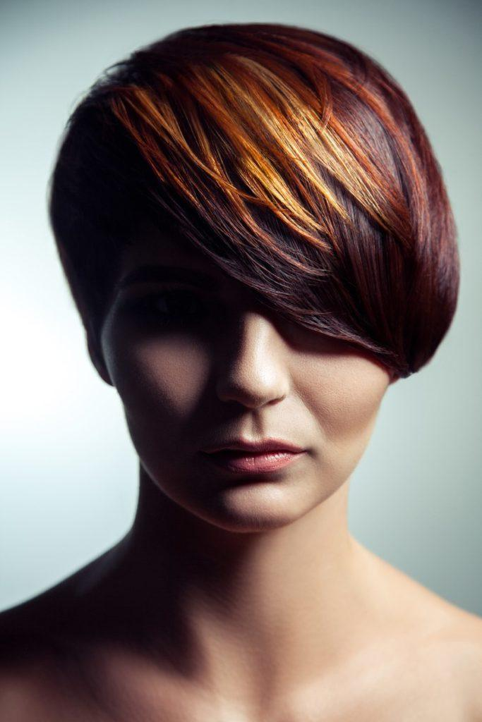 short red hairstyles deep side part pixie