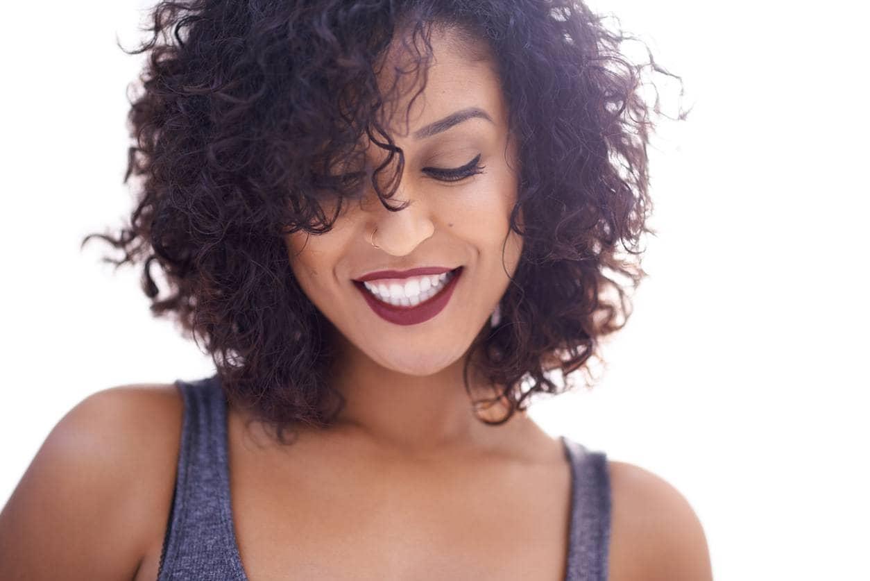 curly hair hairstyles side swept bangs