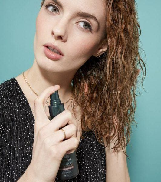 how to brush curly hair spray product