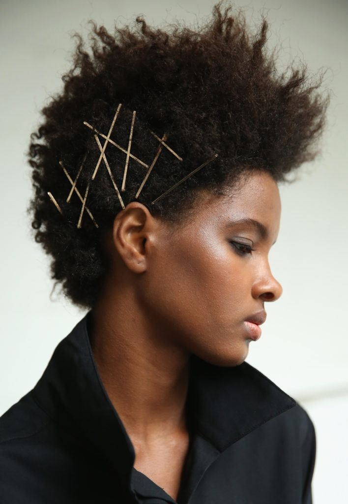 woven and pinned pony: Natural hair mohawk