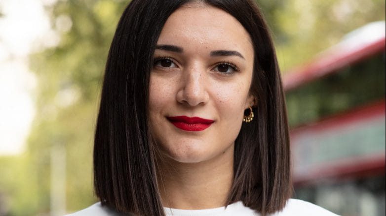 Woman with medium-length dark haircut