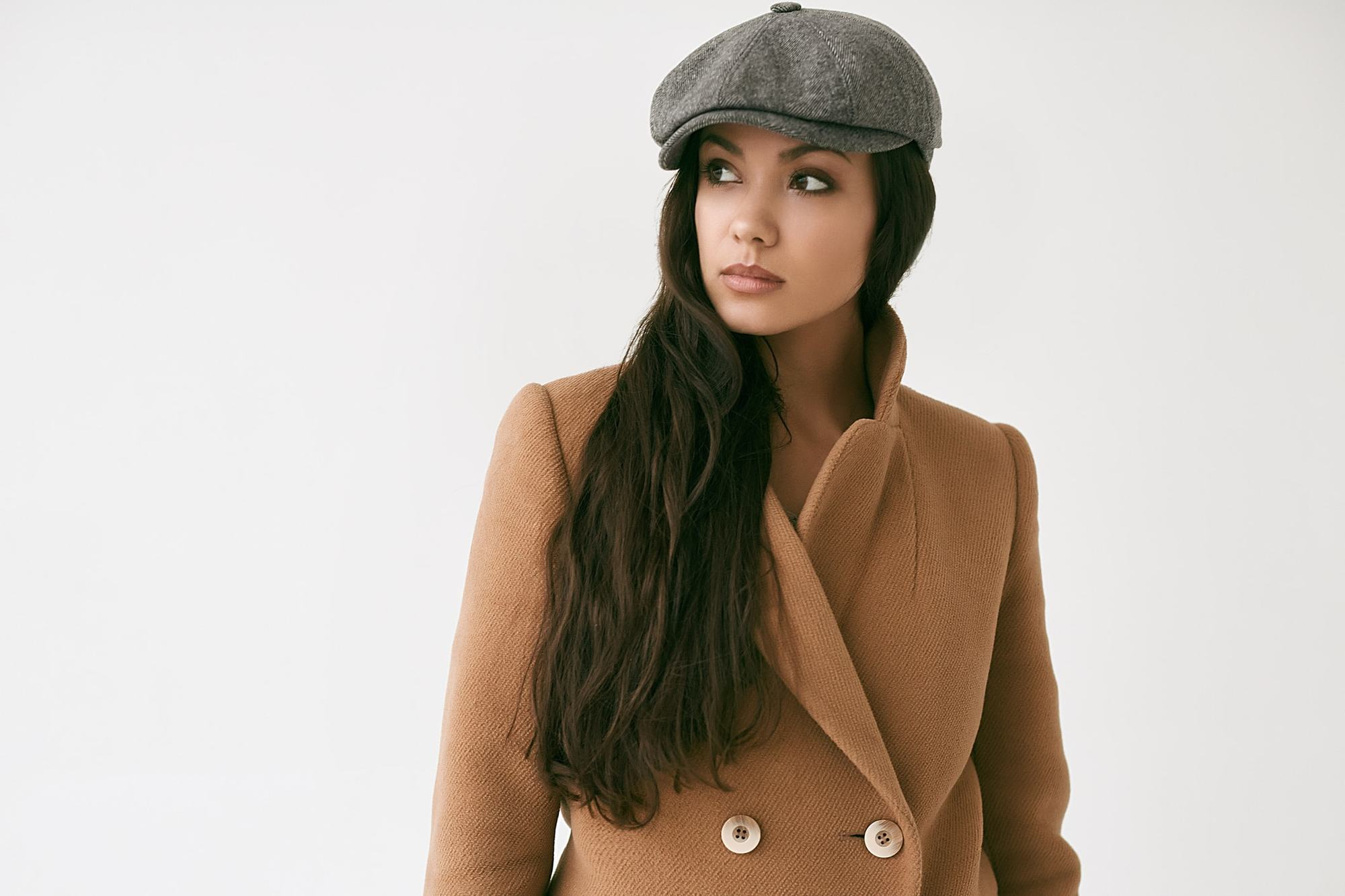 winter hair trends long waves newsboy cap