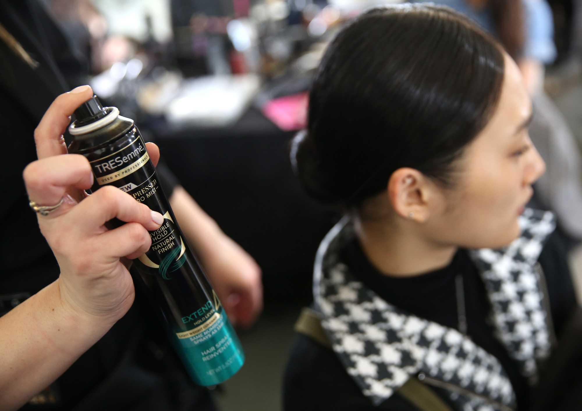 sleek knotted bun tresemme compressed spray