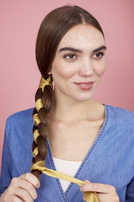 braids with ribbon secure the end