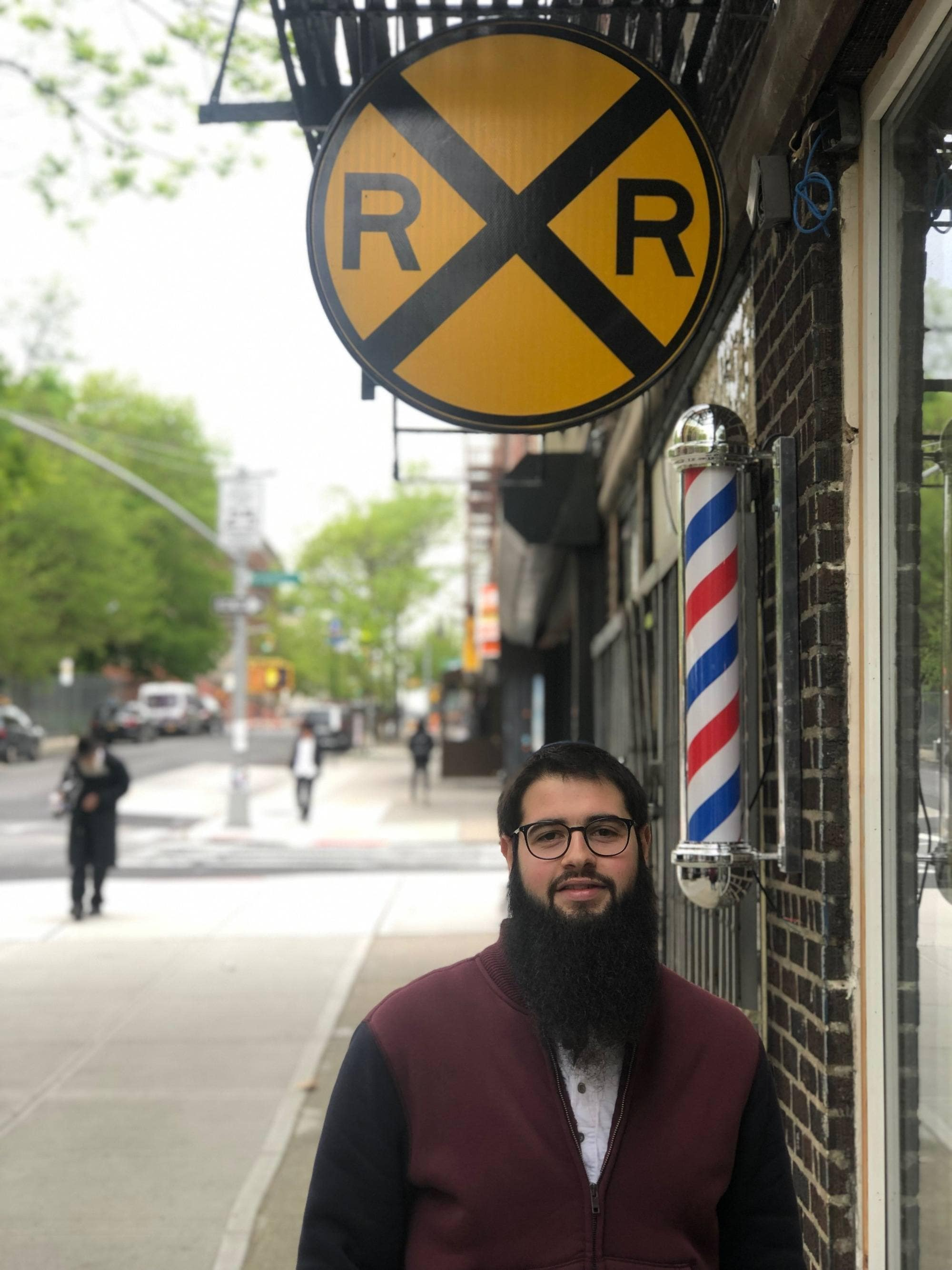the railroad barber Levi logo