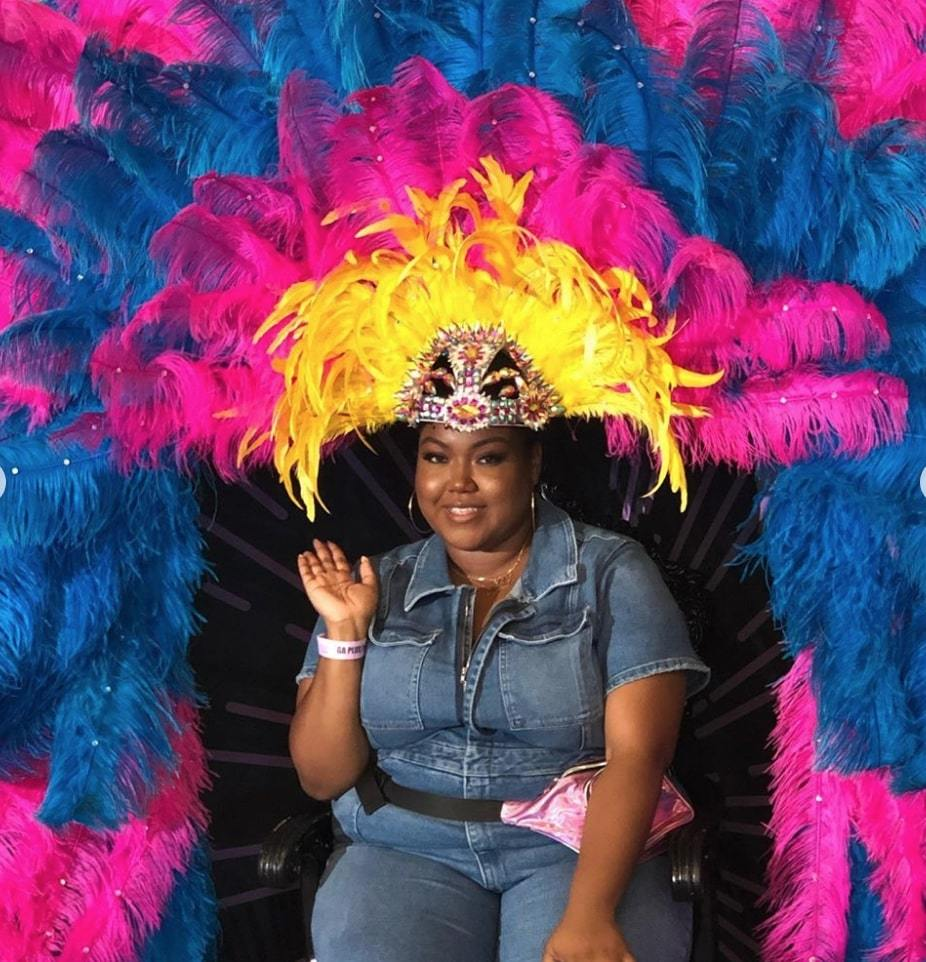 influencer Jazmine Boutte wearing a feathered headdress