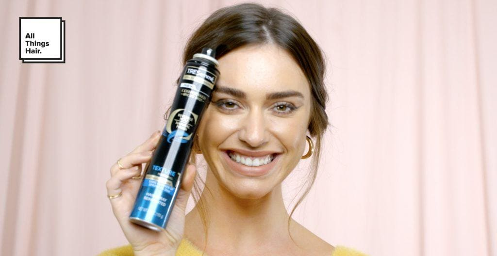 woman holding TRESemmé Compressed Micro Mist Hairspray