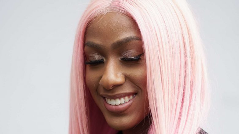 Woman with pink long wig smiling