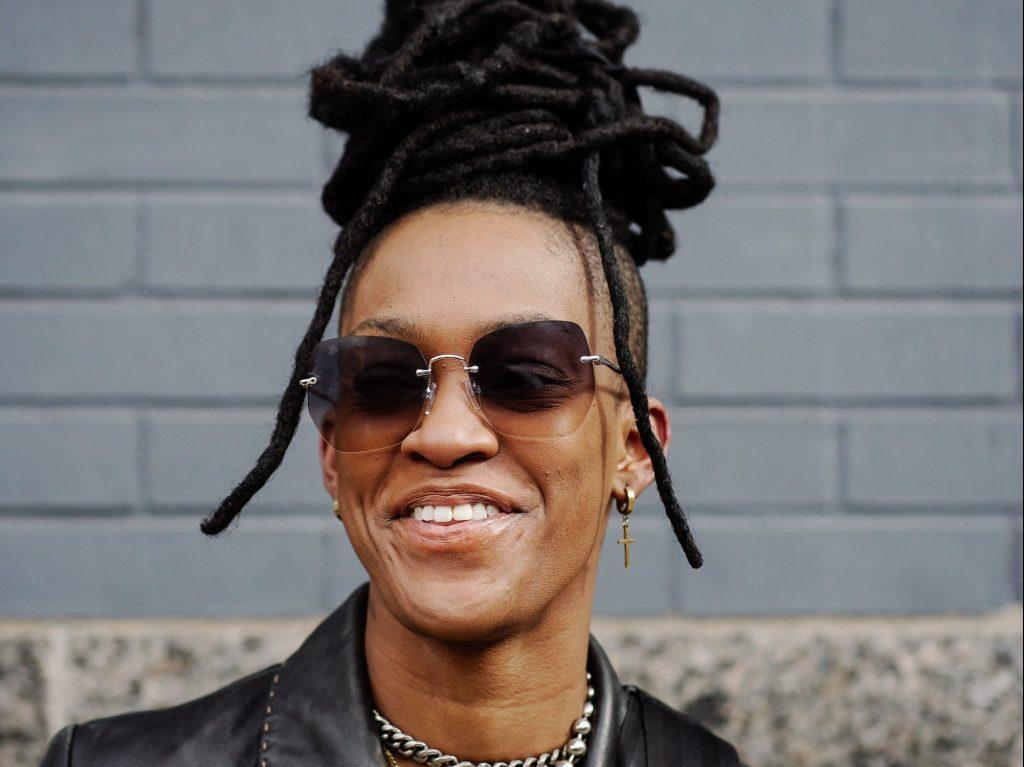Woman with dreadlock bun hairstyle