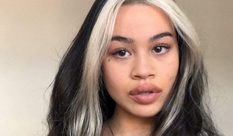 girl with skunk hair streaks