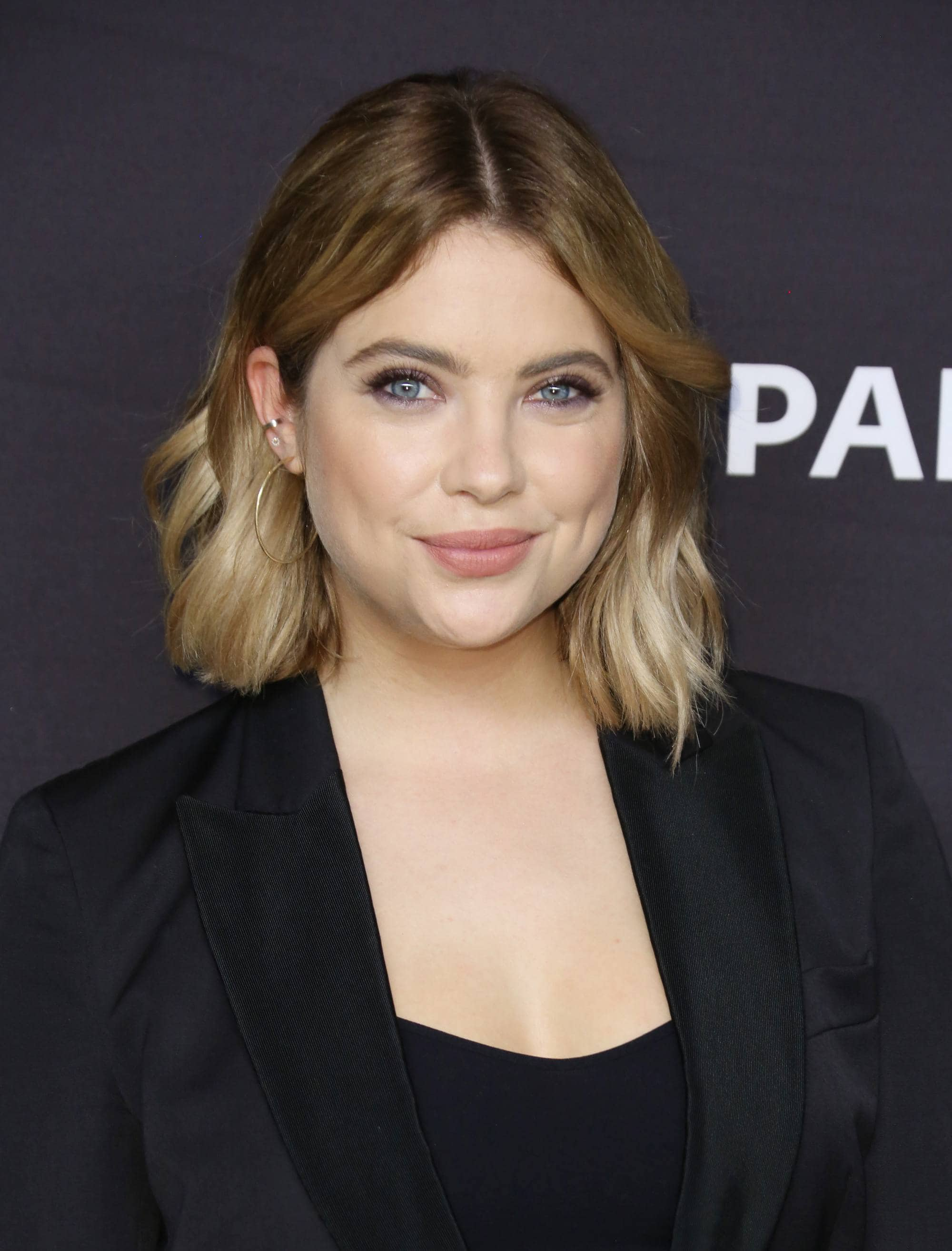 Dirty blonde hair - Ashley Benson lob hair with darker roots and light blonde ends