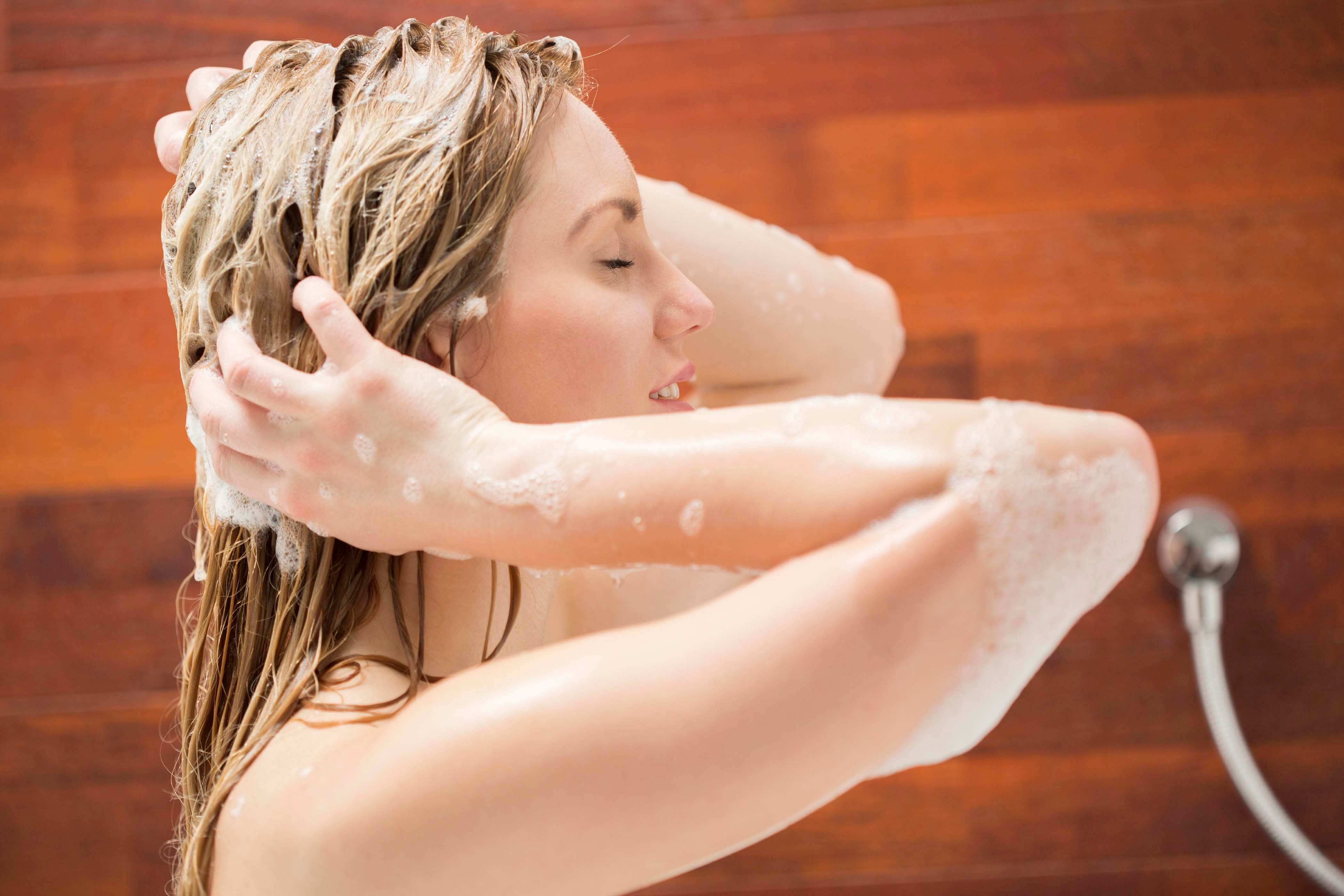 blonde woman washing her hair