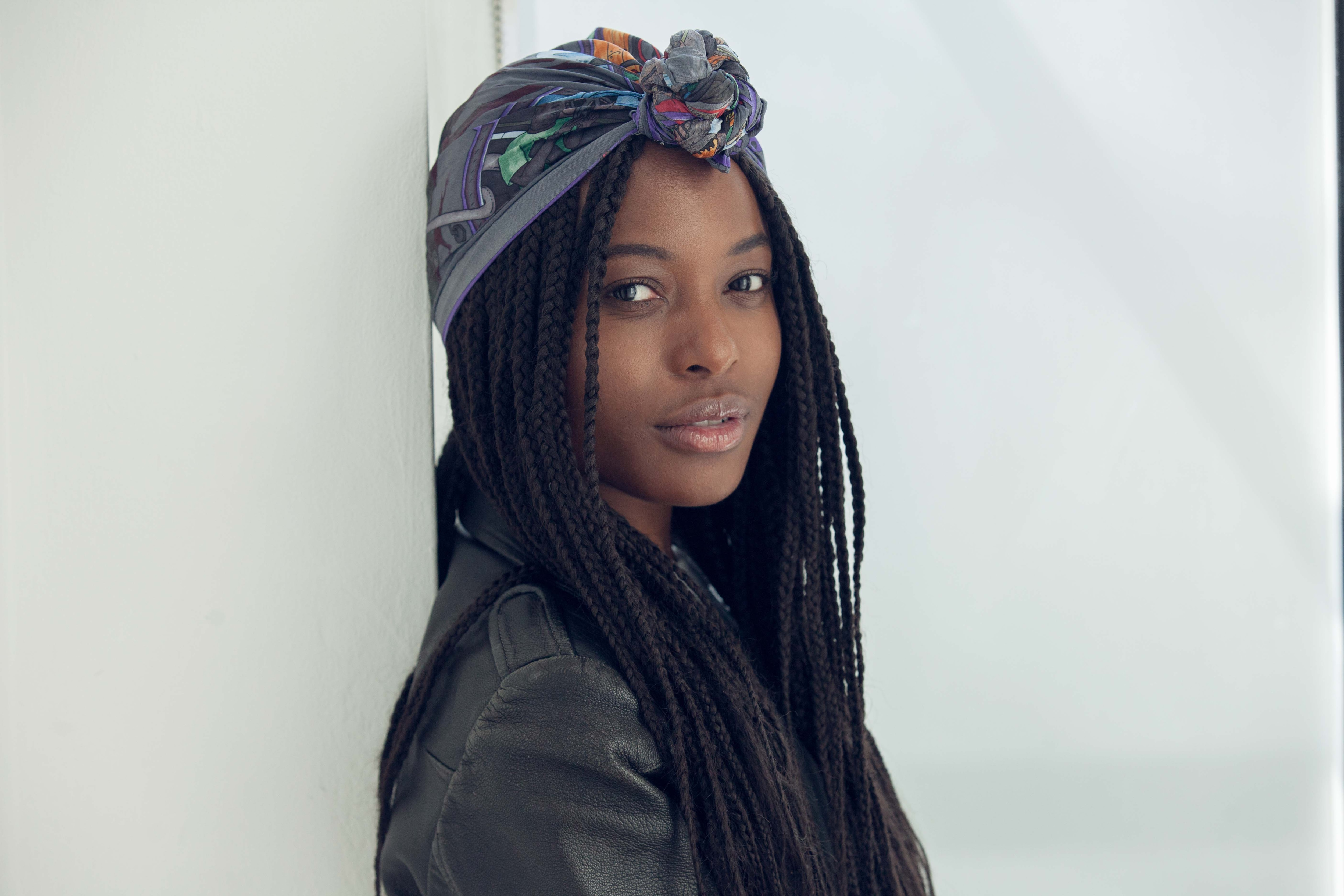 box braids: young black woman with box braids wearing a patterned headscraf