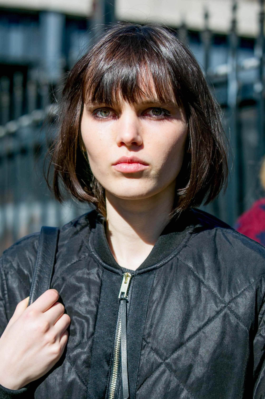 Short hair long fringe: dark haired woman with bob and bangs