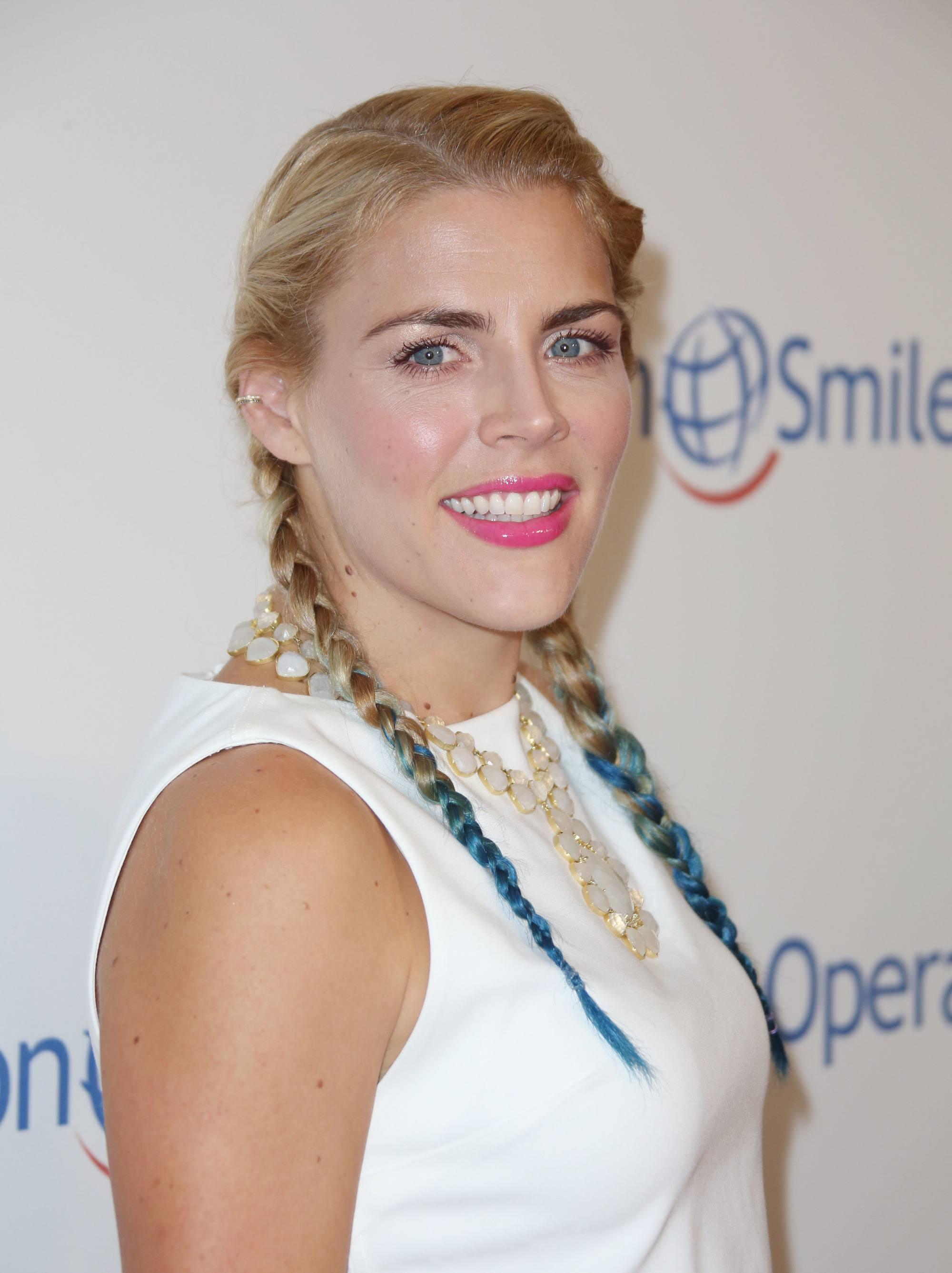 Blue hair: Actress Busy Philipps with blonde to blue dip dyed hair in boxer braids