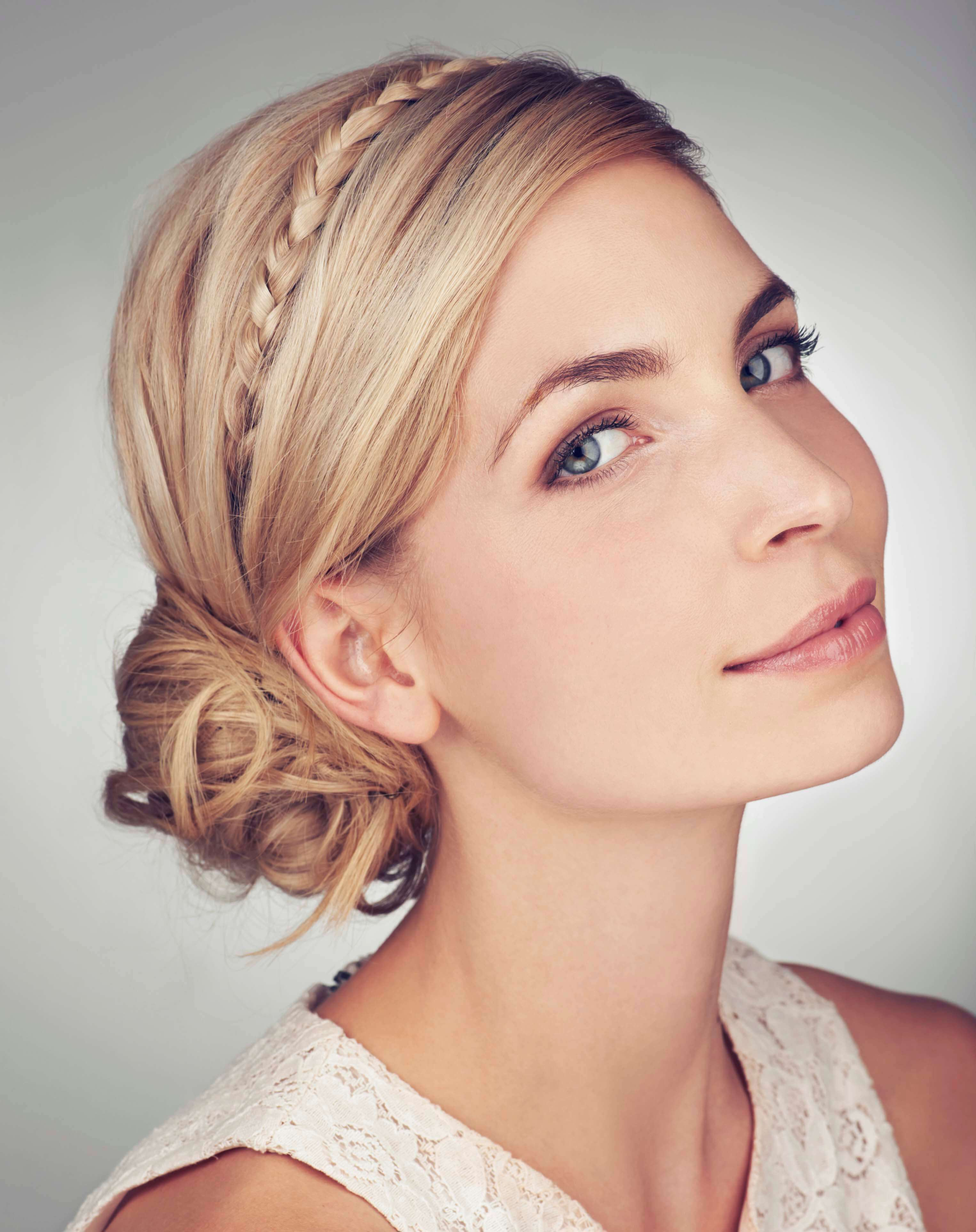 blonde lady with plaited chignon hairstyle