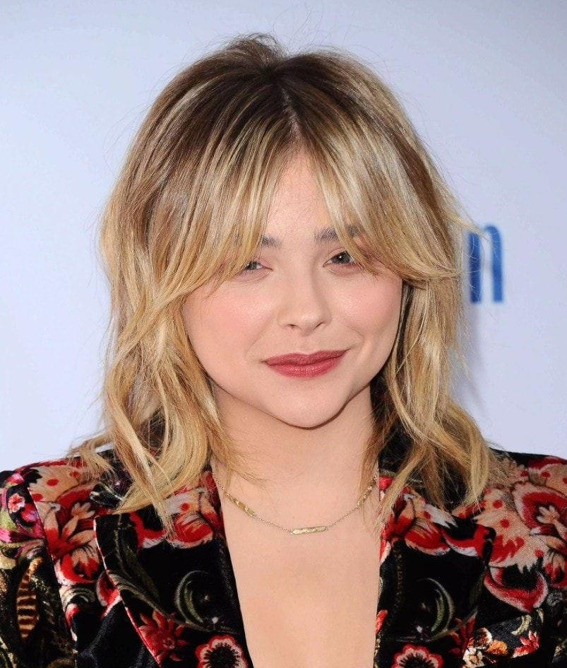 Brown hair with blonde highlights: Chloe Grace Moretz with blonde shag hair with dark grungy roots