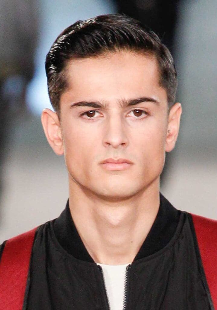 front view image of a man with dark hair a mini quiff hairstyle