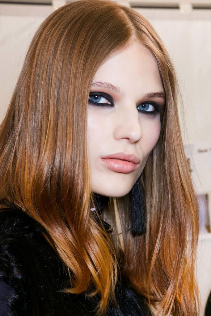 model with long sleek hair and a balayage copper hair at Elie Saab ss16