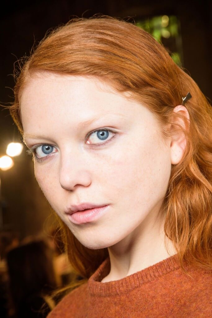 model with a bright ginger copper hair colour