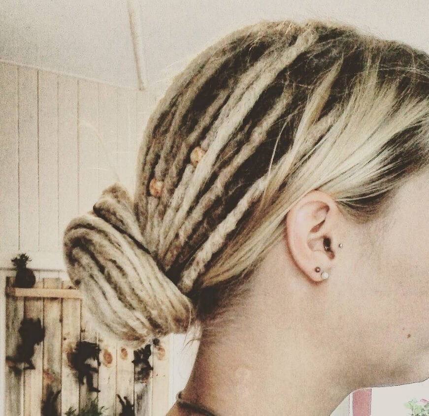 dreadlock hairstyles low bun