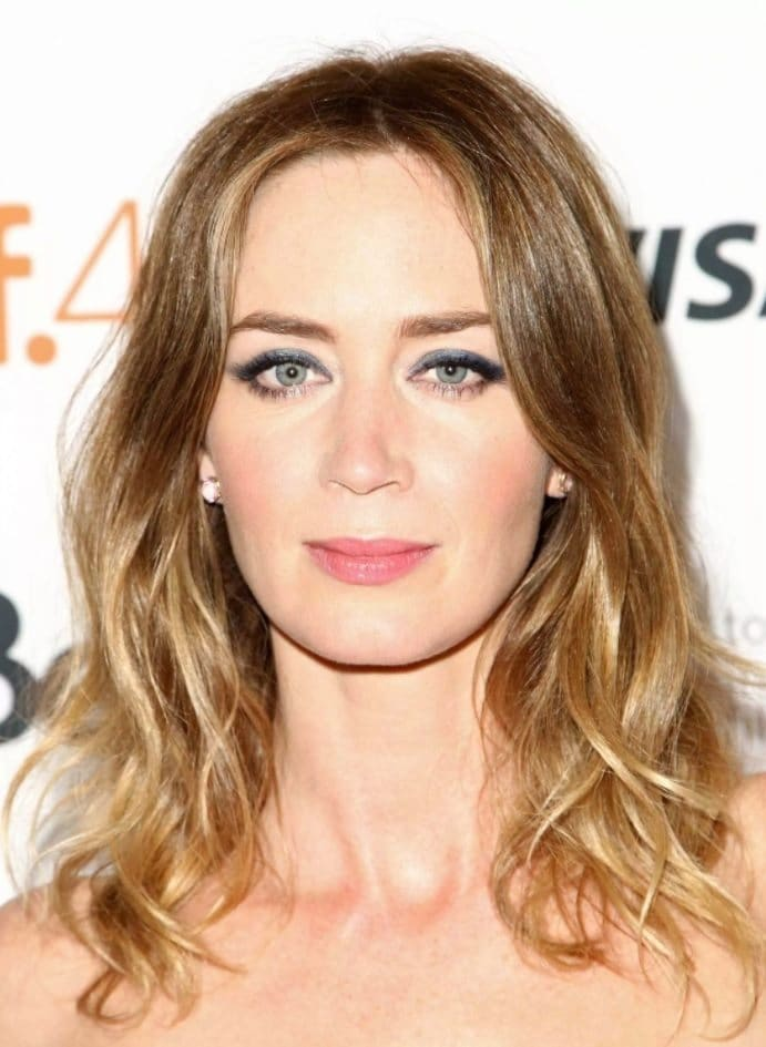 Brown hair with blonde highlights: Emily Blunt with shoulder length soft ombre brown and blonde curled hair