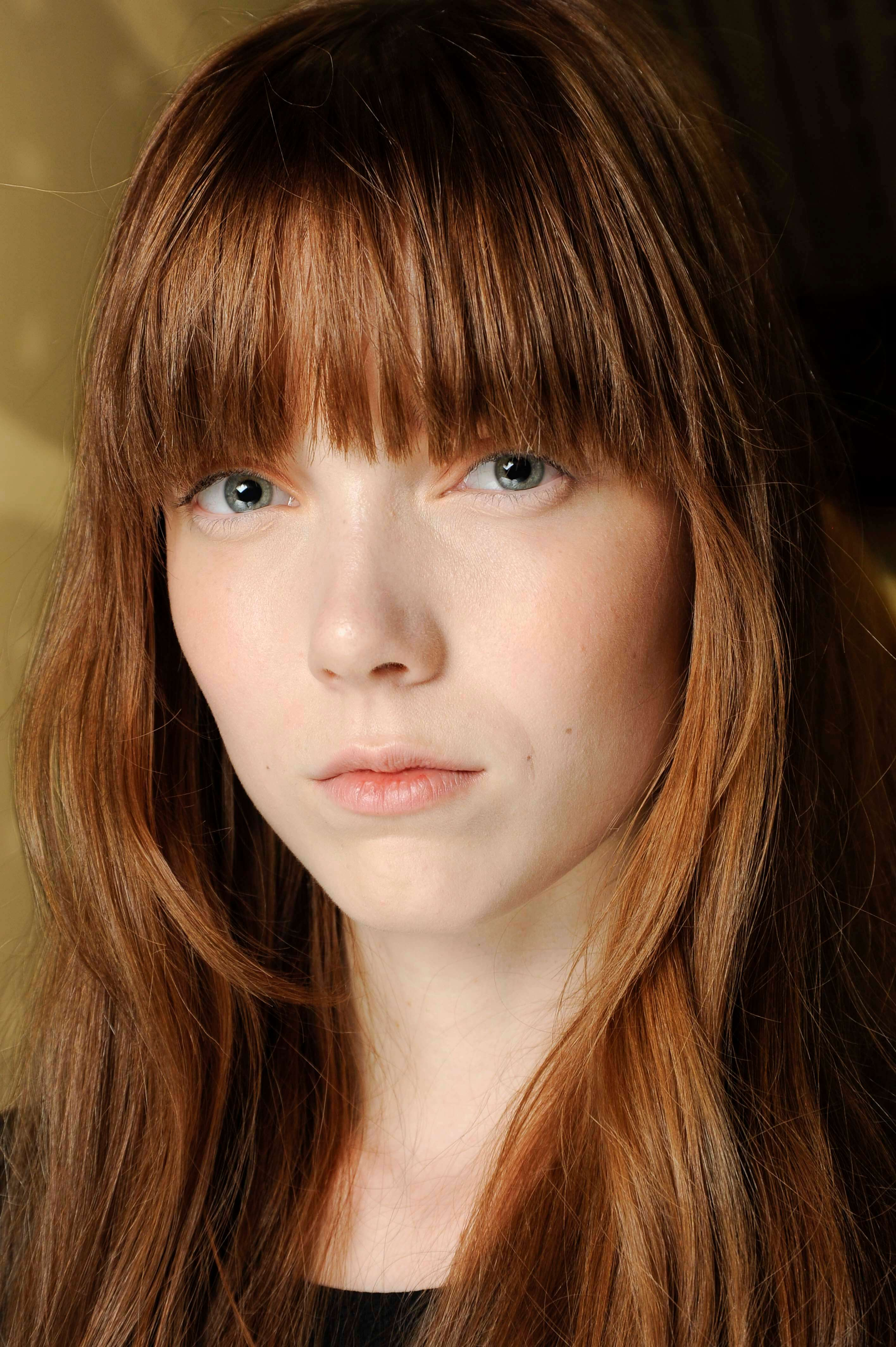 ginger fringe and layers hairstyles for round faces